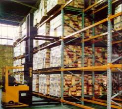 A forklift truck picking a double deep pallet racking